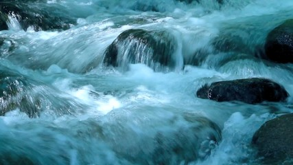 rapid flow of water in a mountain river