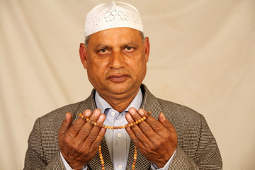 hands with muslim prayer beads