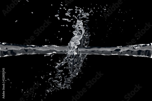 Two waterjet collide on a black background