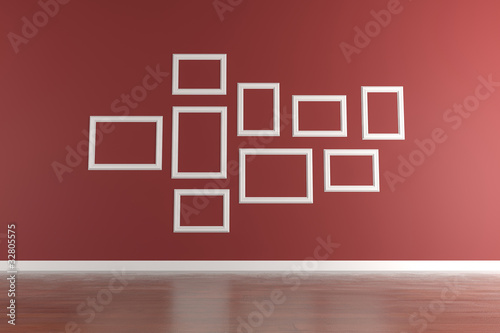 White picture frames on red wall