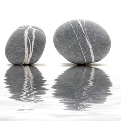 Pair of sea stones reflection