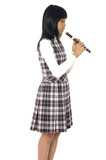 asian girl is playing on a flute