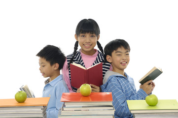 Couple children reading book with apples on book