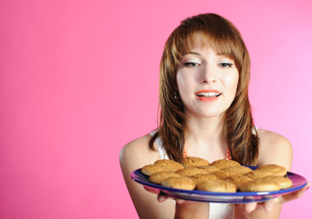 Portrait of young woman smelling cookies