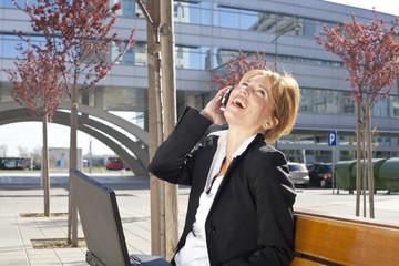 businesswoman enjoying a conversation