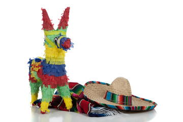 Serape, sombrero and pinata on a white background