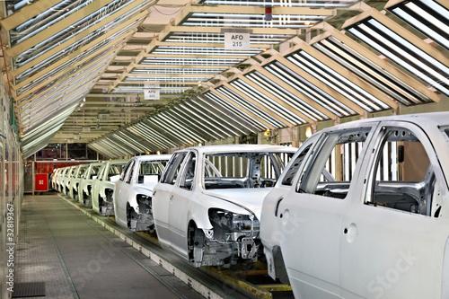 Leinwanddruck Bild cars in a row at car plant