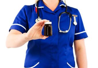 nurse holding medicine
