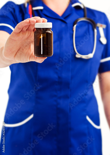 nurse holding drug jar