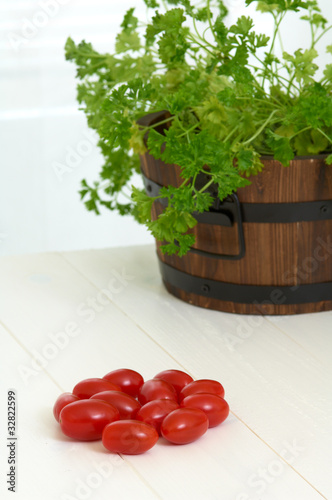 cherry tomatoes on the table, parsley in background
