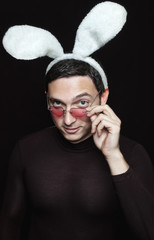 playboy with bunny ears and heart shaped sunglasses on black