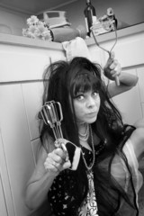 Woman Holds an Egg Beater and Masher