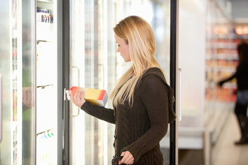 Woman Buying Juice from Cooler