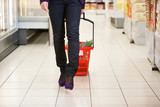 Woman Walking with Shopping Basket