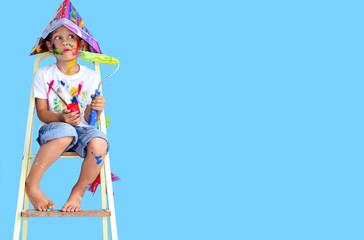 Kind mit Farben