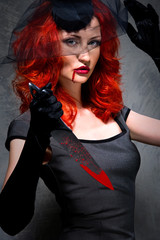 Portrait of a female vampire with bloody knife in hand