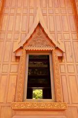 Windows of modern Thai teak temple