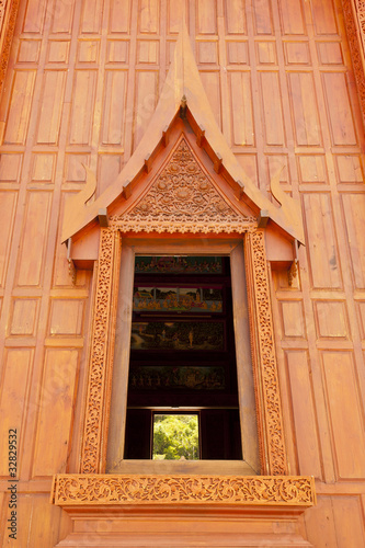 Windows of modern Thai teak temple