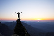 Leinwandbild Motiv Man on the top of the rock