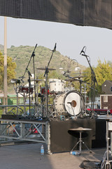 Detail of an open-air stage with a drum set