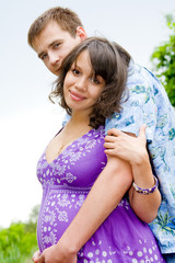 Beautiful young pregnant woman with husband