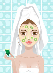 girl with cucumber and kiwi facemask
