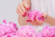 Manicure spa pampering with pink peony flowers