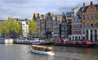 Classical Amsterdam view. Boat floats on the channel