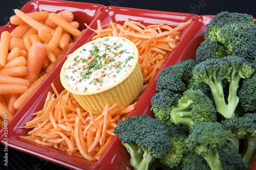 Mix of raw carrots & broccoli in a ceramic dish with ranch dip