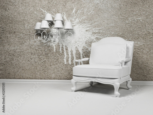 White armchair and a chandelier