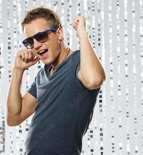 Leinwanddruck Bild Stylish young man in the nightclub