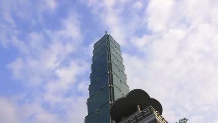 Clouds through skyscraper