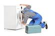 Repairman trying to fix a washing machine