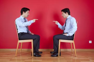 Twin businessman fighting