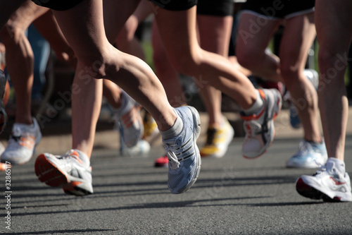 People running in city marathon..