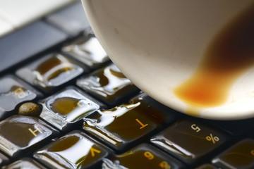 Coffee on computer keyboard