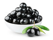 Black olives in a bowl isolated on white