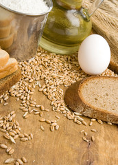 bakery products and grain on wood