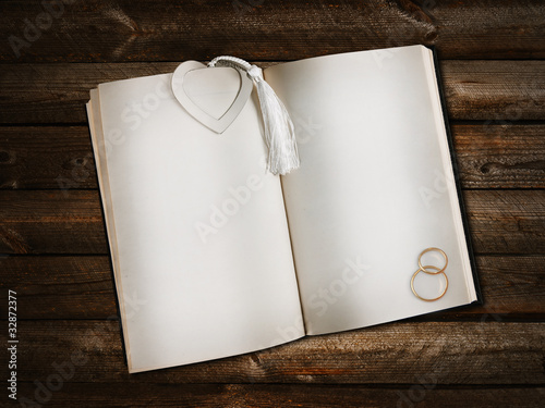 open book with heart bookmark