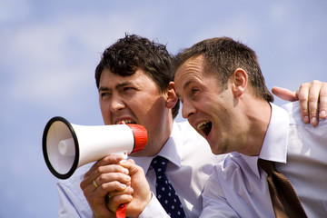 Businessmen with megaphone