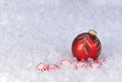 christmas ornament on snow with candy