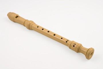 plastic soprano flute on a white background