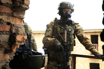 Army Soldier  with weapons  and gas mask.