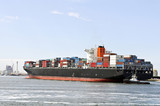 container ship and pilot boat in the harbor of rotterdam