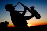 Fototapety Saxophonist at sunset