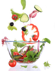 Fresh salad with vegetable in motion.
