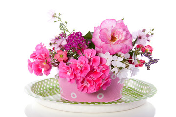 a colorful pink purple garden flower bouquet isolated over white