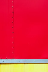 Painted wall of a railway carriage with rivets