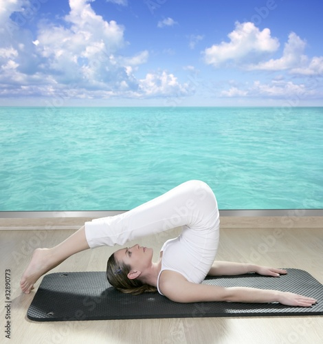 black mat yoga woman window turquoise sea view