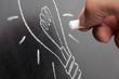 Lightbulb idea on a chalkboard
